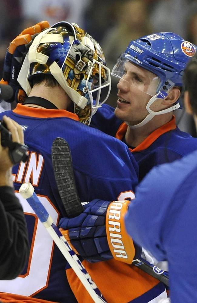 New York Islanders' Casey Cizikas (53) congratulates goalie Kevin Poulin after the Islanders beat the Boston Bruins 3-1 in an NHL hockey game at the Nassau Coliseum on Saturday, Nov. 2, 2013, in Uniondale, N.Y