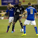 Leicester City's David Nugent, left, and Marc Albrighton, right, challenges Everton's Sylvain Distin for the ball during their friendly soccer match at Suphachalasai stadium in Bangkok, Thailand, Sunday July 27, 2014. Leicester City beat Everton 1-0