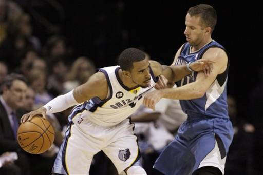 Memphis Grizzlies' Mike Conley, left, pushes Minnesota Timberwolves' Jose Barea, of Puerto Rico, right, during the first half of an NBA basketball game in Memphis, Tenn., Monday, March 18, 2013
