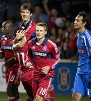 In a photo provided by the Chicago Fire, Chicago Fire's Dominic Oduro, left to right, Alex, Alvaro Fernandez and Chris Rolfe celebrate Fernandez's goal as Montreal Impact's Alessandro Nesta, right, walks up the field during the second half of an MLS soccer game, Saturday, Sept. 15, 2012 in Bridgeview, Ill. (AP Photo/Brian Kersey/Chicago Fire)