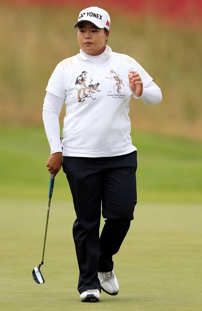 South Korea's Sun Ju Ahn finishes her round as the leader on the third day of the women's British Open golf championship on the Royal Birkdale Golf Club, Southport, England, Saturday July 12, 2014