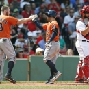 Altuve's slam lifts Astros over Red Sox The Associated Press