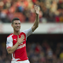 Arsenal's Laurent Koscielny celebrates at the end of their English Premier League soccer match against Crystal Palace, at Emirates Stadium, in London, Saturday, Aug. 16, 2014