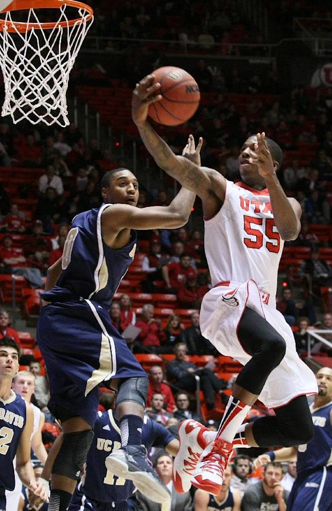 Utah guard Delon Wright (55) drives to the basket past UC Davis guard Lemar Brynton during the first half of an NCAA college basketball game Friday, Nov. 15, 2013, in Salt Lake City