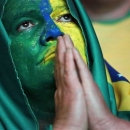 A Brazil soccer fan watches the final Confederations Cup soccer match between Brazil and Spain on a screen in downtown Sao Paulo, Brazil, Sunday, June 30, 2013. (AP Photo/Nelson Antoine)