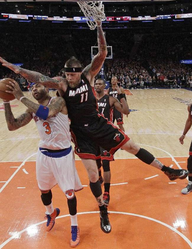 New York Knicks' Kenyon Martin (3) is fouled by Miami Heat's Chris Andersen (11) during the first half of an NBA basketball game on Thursday, Jan. 9, 2014, in New York
