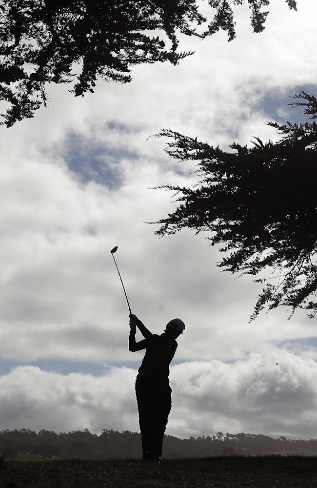Former United States Secretary of State Condoleezza Rice hits from the 12th tee of the Monterey Peninsula Country Club Shore Course during the first round of the AT&T Pebble Beach Pro-Am golf tournament on Thursday, Feb. 6, 2014, in Pebble Beach, Calif