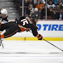 Anaheim Ducks center Ryan Getzlaf is tripped by Minnesota Wild left wing Erik Haula, left rear, of Finland, during the third period an NHL hockey game, Friday, Oct. 17, 2014, in Anaheim, Calif. The Ducks won 2-1 The Associated Press