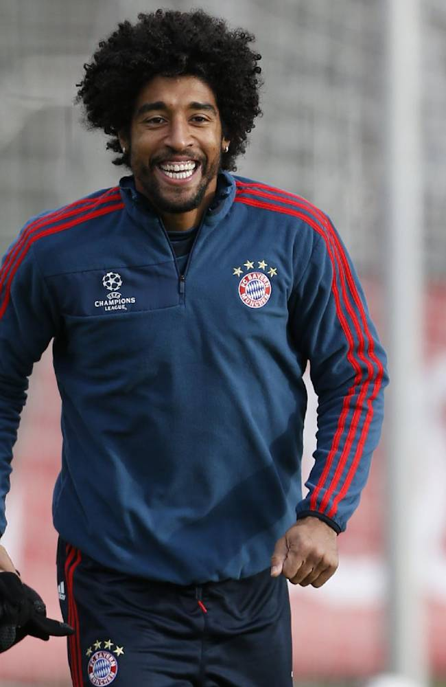 Bayern's Dante of Brazil laughs during a last training session prior the Champions League group D soccer match between FC Bayern Munich and Manchester City, in Munich, southern Germany, Monday, Dec. 9, 2013. Munich will face Manchester Tuesday