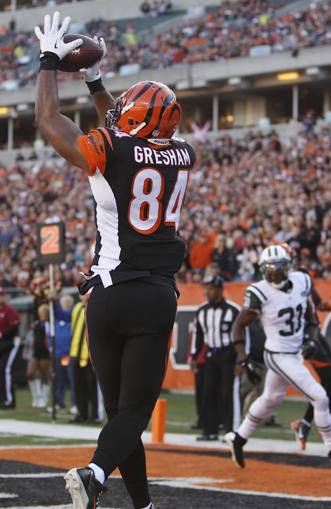 Cincinnati Bengals tight end Jermaine Gresham (84) catches a four-yard touchdown pass against the New York Jets in the first half of an NFL football game Sunday, Oct. 27, 2013, in Cincinnati