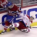 Montreal Canadiens' Brendan Gallagher (11) Washington Capitals' John Carlson (74) tangle during the second period of an NHL hockey game, Thursday, Oct 9, 2014, in Washington. The Canadiens won 2-1 in a shootout The Associated Press