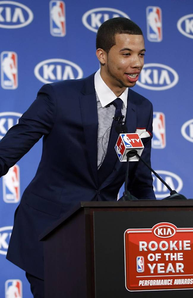 Philadelphia 76ers' Michael Carter-Williams gestures  as he speaks during a news conference where he received the NBA Rookie of the Year award at the team's practice facility, Monday, May 5, 2014, in Philadelphia