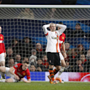 Donetsk's Yaroslav Rakitskiy, centre, turns away and holds his hands to his head in frustration after missing a chance to score a goal during their Champions League group A soccer match between Manchester United and Shakhtar Donetsk at Old Trafford Stadiu