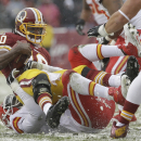 Washington Redskins quarterback Robert Griffin III is sacked by Kansas City Chiefs outside linebacker Tamba Hali during the first half of an NFL football game in Landover, Md., Sunday, Dec. 8, 2013. (AP Photo/Pablo Martinez Monsivais)