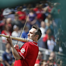 Glenn Donnellan plays the National Anthem on his Electric Slugger before a baseball game between the Washington Nationals and the St. Louis Cardinals, Sunday, April 20, 2014, in Washington The Associated Press