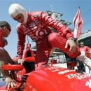 Dario Franchitti, of Scotland, climbs into his car during practice for IndyCar's Indianapolis 500 auto race at the Indianapolis Motor Speedway in Indianapolis, Thursday, May 17, 2012. (AP Photo/Darron Cummings)