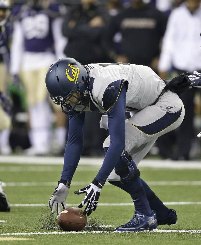 California quarterback Jared Goff reaches for the all after dropping the snap against Washington in the first half of an NCAA college football game Saturday, Oct. 26, 2013, in Seattle
