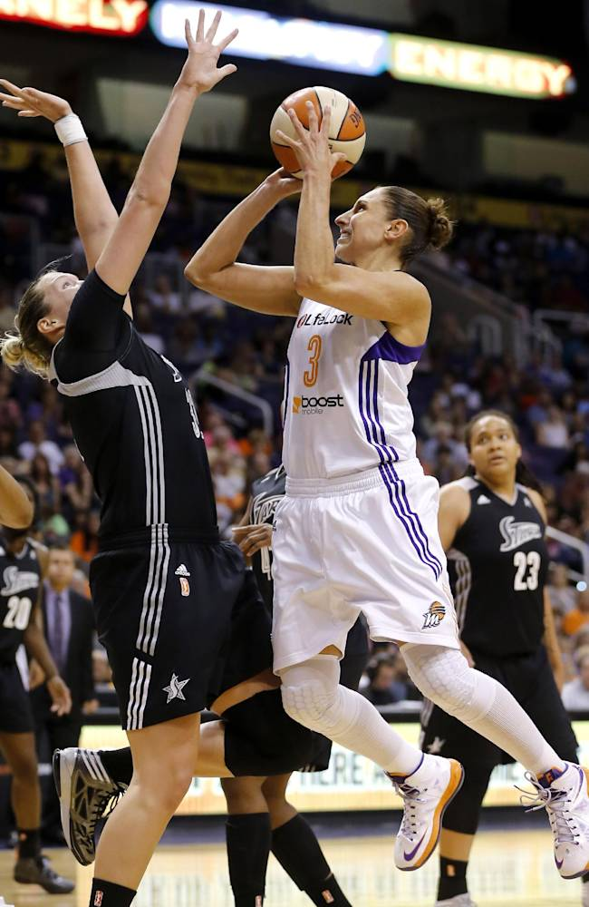 Phoenix Mercury's Diana Taurasi (3) shoots over San Antonio Silver Stars' Jayne Appel during the second half of a WNBA basketball game, Friday, Sept. 13, 2013, in Phoenix