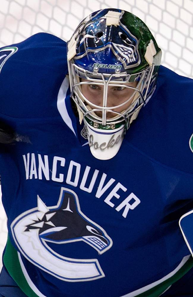 Vancouver Canucks goalie Joacim Eriksson, of Sweden, makes a save during the third period of a pre-season NHL hockey game against the Edmonton Oilers in Vancouver, British Columbia on Wednesday Sept. 18, 2013