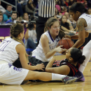 Grand Canyon guard Madison Craig (11), left, Jessica Gajewski, top center, and Courtney Hayes (00), right, battle for the ball with Louisville guard Bria Smith, bottom center, during the first half of an NCAA college basketball game, Thursday, Dec. 18, 2014, in Phoenix. (AP Photo/Rick Scuteri)