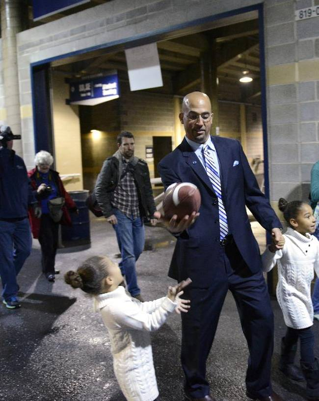 James Franklin, center, plays with his daughters, Shola, right, and Addison, left, after he was introduced as Penn State's new football coach at a news conference at Beaver Stadium, Saturday, Jan. 11, 2014, in State College, Pa