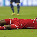 Bayern's Dante holds his head after clashing with Manchester United's Wayne Rooney during the Champions League quarterfinal second leg soccer match between Bayern Munich and Manchester United in the Allianz Arena in Munich, Germany, Wednesday, April 9, 20