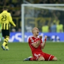Bayern's Arjen Robben of the Netherlands reacts after the final whistle and his team winning 2-1 the Champions League Final soccer match against Borussia Dortmund at Wembley Stadium in London, Saturday May 25, 2013.  (AP Photo/Matt Dunham)