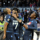 Napoli's Jonathan de Guzmn, right, celebrates with Gokhan Inler after scoring during a Serie A soccer match between Napoli and Cagliari, at the San Paolo stadium in Naples, Italy, Sunday, Nov. 23, 2014. (AP Photo/Salvatore Laporta)