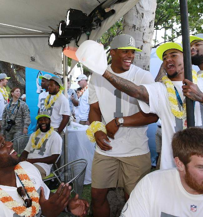 CORRECTS SPELLING OF JACKSON'S FIRST NAME - Philadelphia Eagles' DeSean Jackson (10) grabs the hat off of New Orleans Saints guard Ben Grubbs, left, as Carolina Panthers quarterback Cam Newton (1) laughs during the NFL football Pro Bowl draft, Wednesday, Jan. 22, 2014, in Kapolei, Hawaii