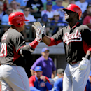 Phillips, Bernadina power Reds past Cubs 8-3 The Associated Press
