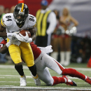 Pittsburgh Steelers wide receiver Antonio Brown (84) makes the catch against Atlanta Falcons cornerback Desmond Trufant (21) during the first half of an NFL football game, Sunday, Dec. 14, 2014, in Atlanta The Associated Press