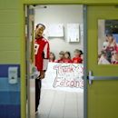 Atlanta Falcons' Steven Jackson waits outside the gymnasium be introduced to students at Shiloh Point Elementary School as part of the NFL's Play 60 Campaign to encourage kids to get 60 minutes of exercise a day, Tuesday, Dec. 3, 2013, in Cumming, Ga. Jac