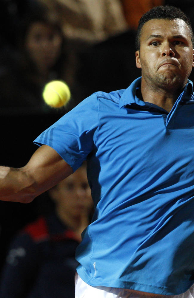 France's Jo-WIlfried Tsonga serves the ball to Ukraine's Alexandr Dolgopolov at the Italian open tennis tournament, in Rome, Monday, May 12, 2014