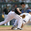 The Arizona Diamondbacks' Aaron Hill, left, and the Los Angeles Dodgers' A.J. Ellis watch to see a double play completed during the second game of their two-game Major League Baseball opening series at the Sydney Cricket Ground in Sydney, Sunday, March 23