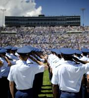 Air Force Academy cadets salute during the national anthem before an NCAA college football game against Colgate Saturday, Aug., 31, 2013, in Air Force Academy, Colo. (AP Photo/The Colorado Springs Gazette, Michael Ciaglo)