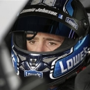 Jimmie Johnson waits in his car before practice for Sunday's NASCAR Sprint Cup series Coca-Cola 600 auto race at Charlotte Motor Speedway in Concord, N.C., Thursday, May 23, 2013. (AP Photo/Chuck Burton)