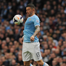 Manchester City's Aleksandar Kolarov controls the ball during the English Premier League soccer match between Manchester City and Sunderland at The Etihad Stadium, Manchester, England, Wednesday, April 16, 2014