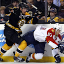 Florida Panthers center Marcel Goc (57) goes down along the boards as he chases the puck against Boston Bruins defenseman Johnny Boychuk (55) during the first period of an NHL hockey game in Boston, Tuesday, March 4, 2014 The Associated Press