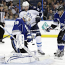 Tampa Bay Lightning goalie Anders Lindback (39), of Sweden, makes a save on a shot by Winnipeg Jets right wing Anthony Peluso (14) as Lightning's J.T. Brown (23) defends during the third period of an NHL hockey game on Saturday, Dec. 7, 2013, in Tampa, Fl