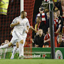 Real Madrid's Karim Benzema, centre, celebrates after scoring his side's third goal during the Champions League group B soccer match between Liverpool and Real Madrid at Anfield Stadium, Liverpool, England, Wednesday Oct. 22, 2014
