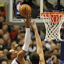 Dallas Mavericks small forward Shawn Marion (0) goes to the basket over Golden State Warriors center Andrew Bogut (12) in the first half during an NBA basketball game on Wednesday, Nov. 27, 2013 in Dallas The Associated Press