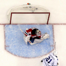 Toronto Maple Leafs left wing James van Riemsdyk (21) scores a goal on New Jersey Devils goalie Cory Schneider (35) during the third period of an NHL hockey game, Wednesday, Jan. 28, 2015, in Newark, N.J. The Devils won 2-1 in a shootout The Associated Pr