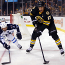 Boston Bruins' Milan Lucic (17) looks to get around Winnipeg Jets' Mark Stuart during the second period of an NHL hockey game in Boston, Friday, Nov. 28, 2014 The Associated Press
