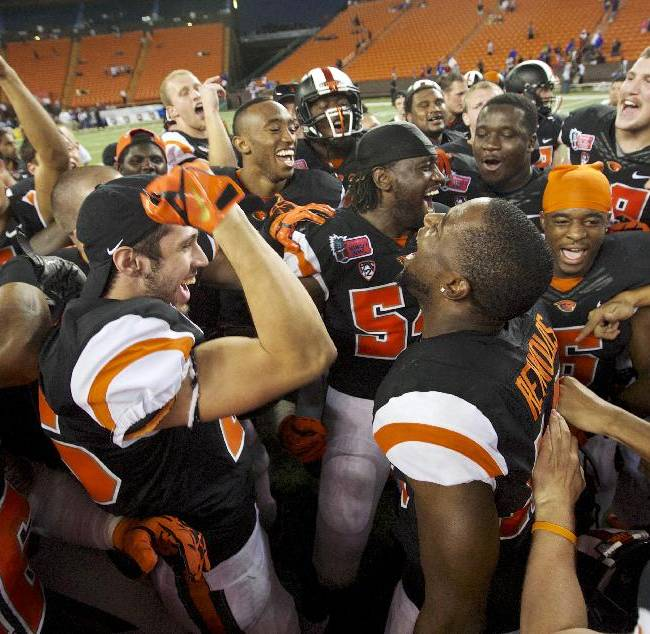 Oregon State cheers after the Hawaii Bowl NCAA college football game against Boise State, Tuesday, Dec. 24, 2013, in Honolulu
