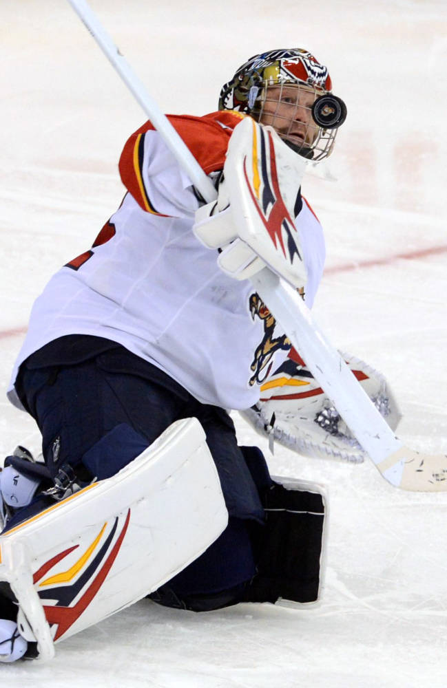 Florida Panthers' Tim Thomas makes a save against the Ottawa Senators' during the third period of an NHL hockey game in Ottawa, Ontario, on Saturday, Nov. 9, 2013