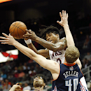 Atlanta Hawks forward Cartier Martin (20) passes the ball as Charlotte Bobcats center Cody Zeller (40) defended in the first half of an NBA basketball game , Monday, April 14, 2014 in Atlanta The Associated Press