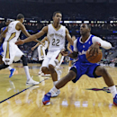 Los Angeles Clippers guard Chris Paul (3) tries to get around New Orleans Pelicans guard Brian Roberts (22) in the first half of an NBA basketball in New Orleans, Monday, Feb. 24, 2014 The Associated Press