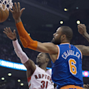 Toronto Raptors guard Terrence Ross (31) and New York Knicks center Tyson Chandler (6) vie for a rebound during the first half of an NBA basketball game Friday, April 11, 2014, in Toronto The Associated Press