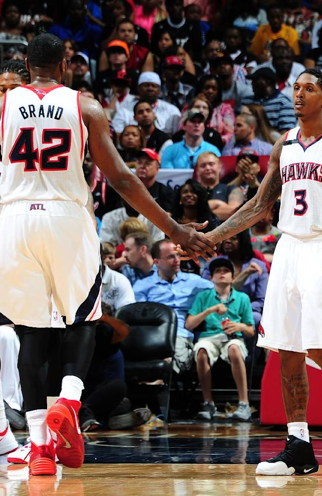 Hawks top Heat 98-85, get East's last playoff spot