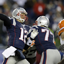 New England Patriots quarterback Tom Brady (12) passes against the Cleveland Browns in the fourth quarter of an NFL football game on Sunday, Dec. 8, 2013, in Foxborough, Mass The Associated Press